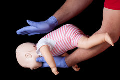 First aid for choking infant. Doctor showing first aid for choking infant royalty free stock photo
