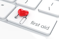 First aid concept red heart and stethoscope on the white compute. 3d render of first aid concept red heart and stethoscope on the white computer keyboard enter Royalty Free Stock Photo