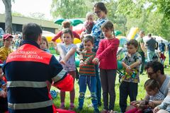 First aid course for children. BRATISLAVA, SLOVAKIA - MAY 18, 2019: Male rescuer demonstrating CPR to kids with an emergency dummy in Bratislava, Slovakia royalty free stock images