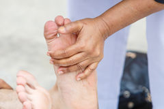 First aid for cramp injury Stock Photo