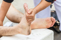 First aid for cramp injury Stock Image