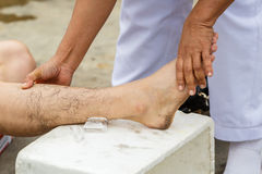 First aid for cramp injury. Photo first aid for cramp injury stock photo