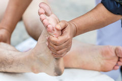 First aid for cramp injury Stock Photos