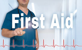 First Aid doctor shows on viewer with heart rate concept Stock Photos