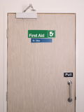First aid door and sign with occupied indicator. At an industrial first aid room, Melbourne 2015 royalty free stock photography
