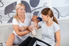 First Aid from fitness trainer Stock Photography