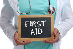 First aid help helping cpr young doctor medical accident. With sign Royalty Free Stock Images