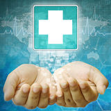 First Aid icon in hand. First Aid icon, Disabled symbol in hand Stock Photo