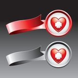 First aid icon in a heart on red and gray ribbons Royalty Free Stock Image