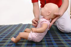 Infant medical examination demonstration Stock Photos
