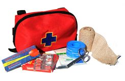 First Aid Kit. With content: bandage, bandaid, painkillers, gauze and scissors Royalty Free Stock Photography