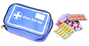 First aid kit. With tablets isolated on whie background Stock Image