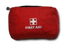 First Aid Kit. A red first aid kit isolated on a white background Stock Photography