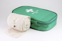 First Aid Kit #3. A first aid kit on white with bandage roll Royalty Free Stock Photos