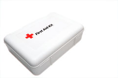 First Aid Kit. A white first aid kit with the universal red cross symbol Royalty Free Stock Photos