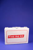 First Aid Kit. Vertical photo of a first aid kit on a blue background Royalty Free Stock Photo