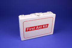 First Aid Kit. Horizontal photo of a first aid kit on a blue background Stock Images