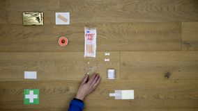 First Aid Kit being laid down on a wooden surface stock video footage