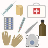 First aid kit box with medical equipment. Bandage, syringe, tweezers, capsules, thermometer respiratory mask gloves first-aid kit bottle Royalty Free Stock Image