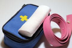 First aid kit for first aid in case of trauma, tourniquet for st. Opping bleeding, bandage for bandaging Stock Photo