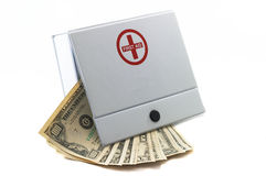 First aid Kit with Cash. Cash in first aid kit, indicates using cash in dire situations, or to indicate expensive hospitalization bills, health care expenses stock images