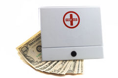 First aid Kit with Cash. Cash in first aid kit, indicates using cash in dire situations, or to indicate expensive hospitalization bills, health care expenses royalty free stock photos