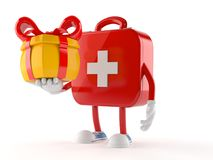 First aid kit character holding gift. Isolated on white background Stock Image