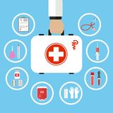 First aid kit in doctor hand. Medical help.Healthcare insurance concept. Medical first aid kit with different pills, syringe and thermometer in hand. Healthcare Royalty Free Stock Photo