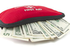First aid kit with dollar Stock Photo