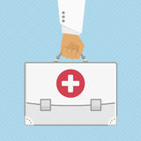 First aid kit in hands doctor. Vector illustration a bag, the first aid kit in the doctor hand in flat stule. Illustration concept health care and ambulance Stock Photography