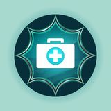 First aid kit icon magical glassy sunburst blue button sky blue background vector illustration