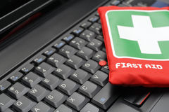 First aid kit on laptop keyboard royalty free stock photography