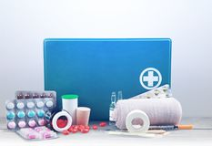 First aid kit  with medical supplies on light. Medical first aid first aid kit medical supplies healthcare and medicine still life medical equipment Royalty Free Stock Photography