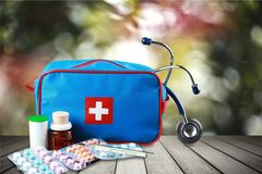 First aid kit  with medical supplies on light. Medical first aid first aid kit medical supplies white background healthcare and medicine still life Stock Images