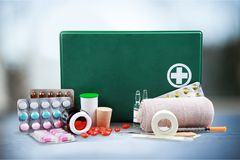 First aid kit  with medical supplies on light. Medical first aid first aid kit medical supplies white background healthcare and medicine still life Royalty Free Stock Image