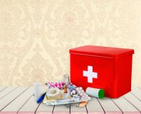 First aid kit with medical supplies on wooden. Medical first aid first aid kit medical supplies white background healthcare and medicine still life Stock Photos