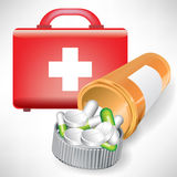 First aid kit and pill bottle. First aid kit and open pill bottle Royalty Free Stock Photos