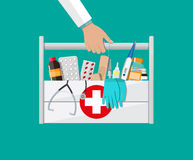 First aid kit with pills and medical devices. Mediacal first aid kit in doctors hands with different pills and medical devices, Pill and care healthy, healthcare Stock Images