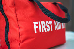 First Aid Kit. A red first aid kit bag with a black zip and handle, in closeup royalty free stock photo