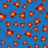 First Aid Kit Seamless Pattern. On Blue Background. Medical Texture Stock Photo
