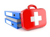 First aid kit with stack of ring binders Stock Images
