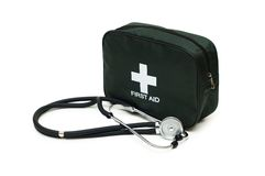 First aid kit and stethoscope. Isolated on the white Royalty Free Stock Photo