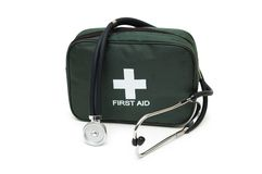 First aid kit and stethoscope. Isolated on the white Stock Photography
