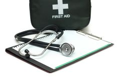 First aid kit, stethoscope. And pad isolated on white Stock Photos