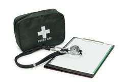 First aid kit, stethoscope and pad Stock Photo