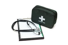 First aid kit, stethoscope and pad. Isolated on white Royalty Free Stock Photography