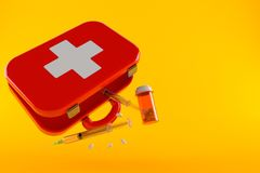First aid kit with syringe and drugs Stock Images
