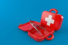 First aid kit with syringe. Isolated on blue background Stock Photo