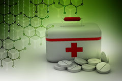 First aid kit with tablet medicines. In color background Royalty Free Stock Image