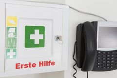 First aid kit with telephone stock photography